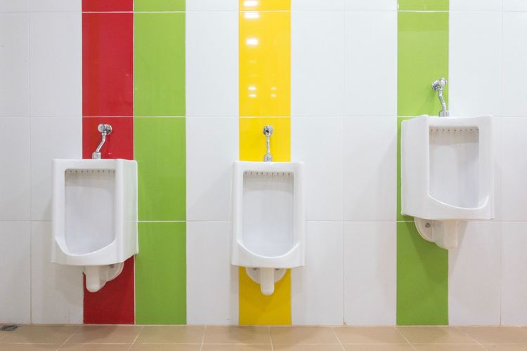 Urinal 3 different sizes. Installed with colorful wall tiles. EyeEm Selects Bathroom Hygiene Public Building Indoors  Domestic Bathroom Public Restroom Toilet No People Domestic Room White Color Tile Wall - Building Feature Convenience Multi Colored Clean Domestic Life