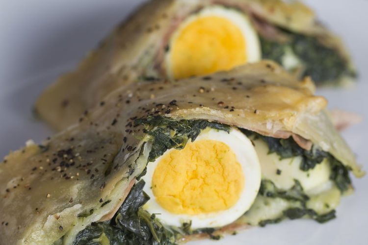 Two slices of puff pastry roll filled with spinach, cheese and hard-boiled egg, Dinner Filled Hard-boiled Lunch SLICE Vegetarian Baked Cheese Close-up Delicious Egg Food Garnish Gourmet Meal Phillo Plate Puff Pastry Spinach Tasty Temptation