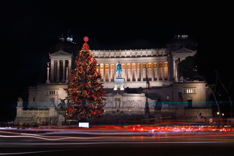 Rome, Italy - Piazza Venezia festively decorated, with the Christmas tree. In the background the monument to Vittorio Emanuele II, last king of Italy. Long exposure Illuminated Night Architecture Long Exposure Light Trail Building Exterior Motion Christmas Built Structure City Transportation Road Speed Blurred Motion christmas tree Street No People Celebration Tree Nature Christmas Christmas Lights Christmas Decoration Christmas Ornament Rome, Italy