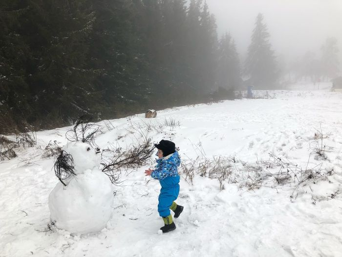 Cold Temperature Children Photography Playing Toddler  Family Children Snowman Snow Winter Cold Temperature Childhood Child Full Length One Person Nature Land Real People Leisure Activity Boys Males  Beauty In Nature Warm Clothing Day Men Offspring Outdoors Snowing