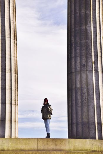 Calton Hill Edinburgh Scotland Architectural Column Architecture Built Structure Day Full Length Leisure Activity Lifestyles Nature One Person Outdoors People Real People Rear View Sky Standing Travel Destinations Young Adult
