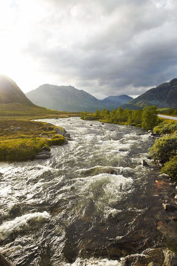 Norwegian Landscape with a river and mountains. Vertical format Beauty In Nature Clouscape Cultures Day Dramatic Sky Landscape Mountain No People Nordic Norway Norway🇳🇴 Outdoors River Scandinavia Scandinavian Sunlight Vertical