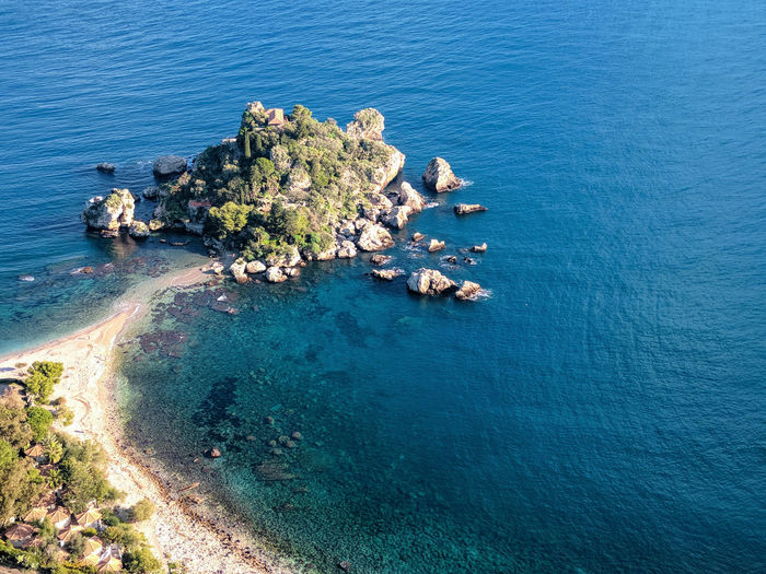 Beautiful island - Taormina Water Tree Sea Beach Blue High Angle View Rock - Object Idyllic Sky Architecture Rocky Coastline Rugged Cliff Rocky Mountains Eroded Bay Coastline Foreground Seascape Boulder Rock Pebble Beach Rock Formation Geology Coast