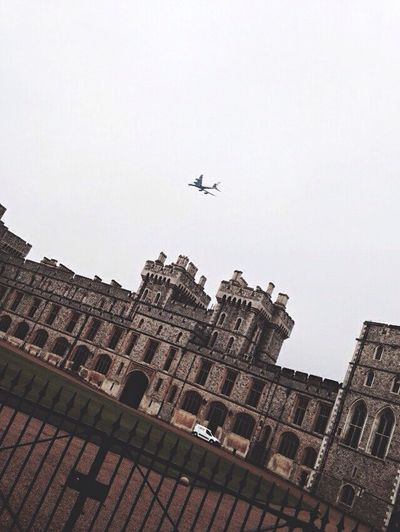 Flying Airplane Low Angle View Transportation Building Exterior Air Vehicle Built Structure Travel Architecture Mode Of Transport Mid-air No People Outdoors Day City Sky England First Eyeem Photo City London History Architecture Amazing Fly
