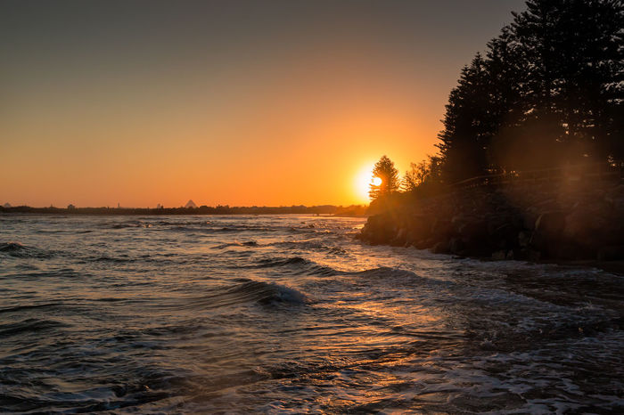Surf At The Sunset Atmosphere Atmospheric Mood Australia Beach Beauty In Nature Caloundra Horizon Over Water Light Ocean Outdoors Power In Nature Queensland Rippled Scenics Sea Seascape Shore Sun Sunset Surf Tranquil Scene Travel Water Waterfront Wave