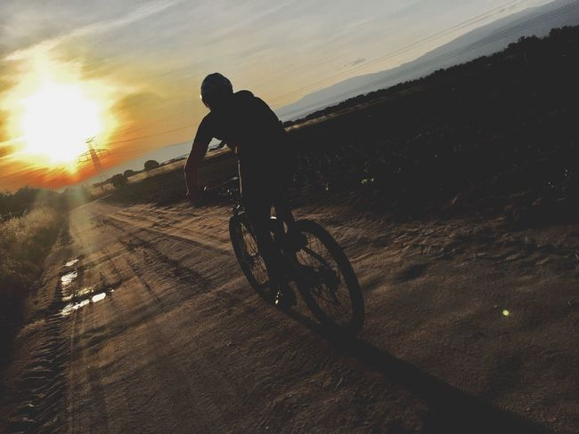 Bicycle One Person Transportation Sunset Real People Sky Lifestyles Road Ride