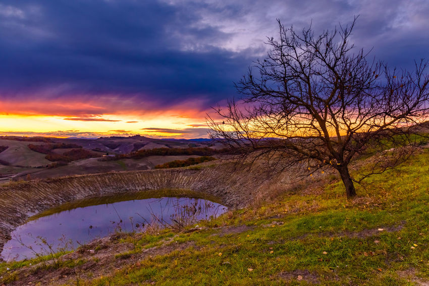 Crete Senesi Torre A Castello Bare Tree Beauty In Nature Chianti Cloud - Sky Day Grass Italian Landscape Mountain Nature No People Outdoors Scenics Sky Sunset Tranquil Scene Tranquility Tree Water