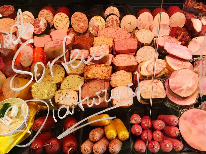 Meat seen through display cabinet at store for sale