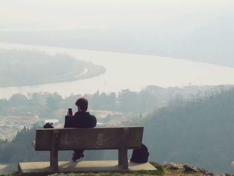 France Cotes Du Rhone Landscape Sitting Sitting Outside Sitting Alone Sitting On A Bench Only Men One Person Solitude Nature Bench Leisure Activity Winter Rear View People Adult Adults Only Warm Clothing Outdoors Big River Fog Foggy Landscape Cold Weather Flying High