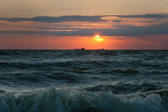 Azov Sea Barge Beating Of Waives Beauty In Nature Boat Horizon Over Water Idyllic Nature No People Orange Color Outdoors Scenics Sea Sky Sun Sunset The Beat Of Waves Tranquil Scene Tranquility Trawler Vessels Water Waterfront Wave