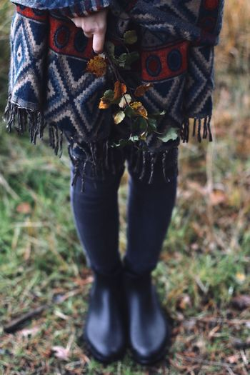 Low section of forest girl wearing shoes standing