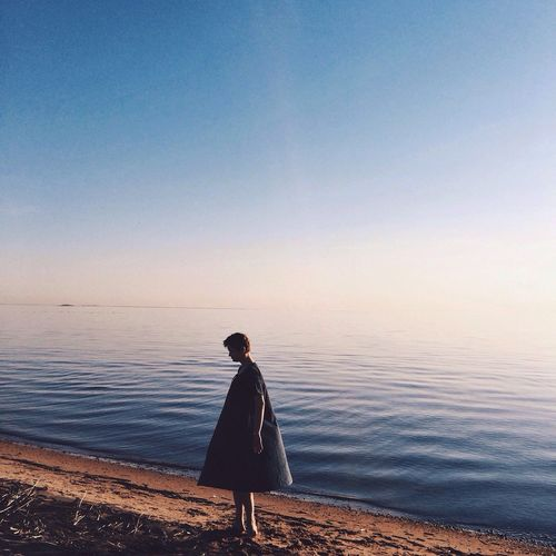One Person Water Tranquility Full Length Tranquil Scene Nature Standing Sea Beauty In Nature Horizon Over Water Sky Sunset Scenics Outdoors People Day Adults Only Adult One Man Only