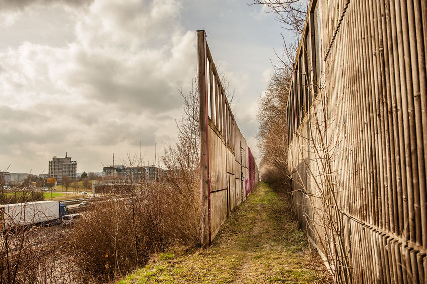 There are two paths you can go by Cloud Cloud - Sky Cloudy Day Diminishing Perspective Industrial Landscapes Motorway Narrow Nature No People Outdoors Overcast Sky The Way Forward Traffic Vanishing Point Walkway