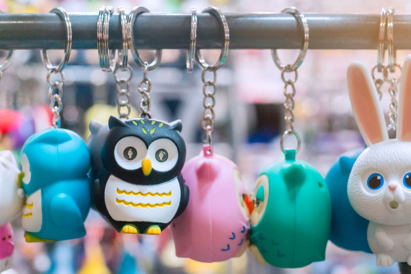 Close-up of key rings hanging for sale at market stall