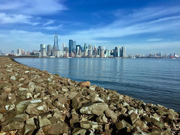 True to where I'm from. Bottom of the rocks looking up at opportunity! Architecture Skyscraper Building Exterior Built Structure City Water Sky Sea Urban Skyline Cityscape Tower Travel Destinations Modern Outdoors Cloud - Sky Downtown District Day No People Blue Nature