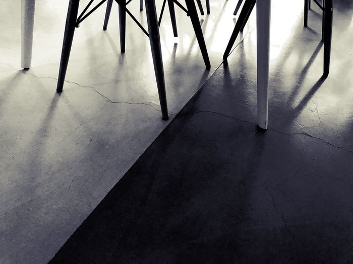 Shadows Reflection Blackandwhite Light And Shadow Chair Legs Table Lines Day Perspective Indoors  Domestic Life Close-up No People Low Section Indoors  Flooring Architecture Absence Shadow Empty Metal Tiled Floor Seat Sunlight Silhouette