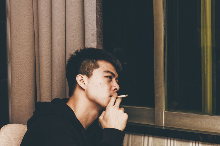thinking Dressing Hairstyle Man Window Future Bad Habit Addiction Smoking - Activity Social Issues Smoking Issues Portrait Cigarette  Window Sill Looking Through Window Smoking Thoughtful