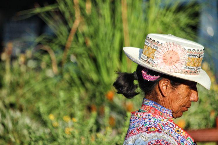 Peruvian woman Portrait Women Rural Scene Tree Flower Headshot Asian Style Conical Hat Headwear Multi Colored Beauty Rear View