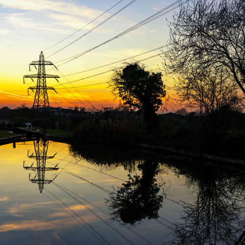 Views along the canal in Worcester, UK Canals And Waterways Worcester Waterways Landscape_photography Reflections In The Water Sunset Sky Reflection Tree Electricity  Cable Silhouette Electricity Pylon Power Line  Water Technology Lake Plant Beauty In Nature Orange Color Tranquility Nature No People Scenics - Nature Power Supply Outdoors Telephone Line
