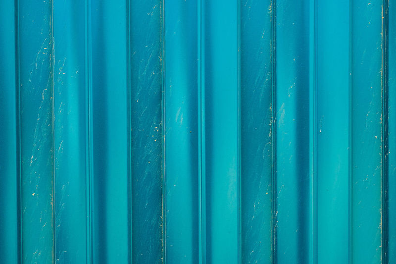 Full frame shot of blue metal fence