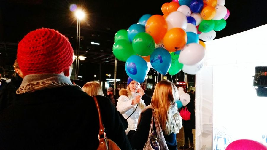 Suomi100 Colorful Balloons Balloons Multi Colored Woman Giving Away Balloons Woman Handing Balloons Night Shot On The Act Shot On The Act Photography