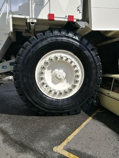 Big tire on a big truck Machinery Day Automobile Industry