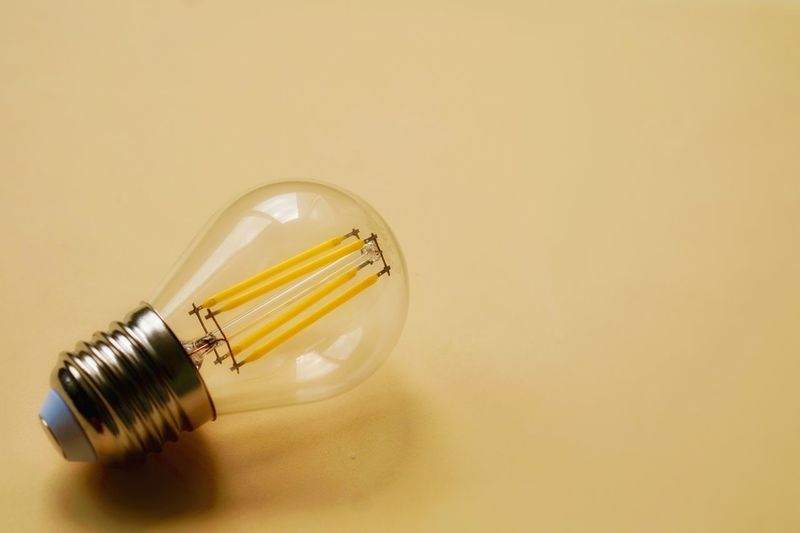Close-up of yellow light bulb
