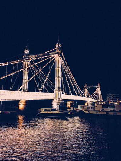Bridge over the Thames at night. Big Bridge Boats Bridge Bright Darkness And Beauty Harbor Harbour Lights London Night Lights Nightscene Reflections Thames Thames River Water White Light White Line