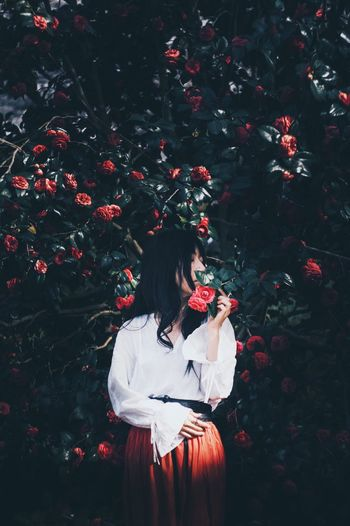 camellia Camellia Flower Camellia EyeEm Best Shots Portrait People Vscocam Woman Portrait Light And Shadow Real People Lifestyles One Person Leisure Activity Nature Women Red Plant Flower