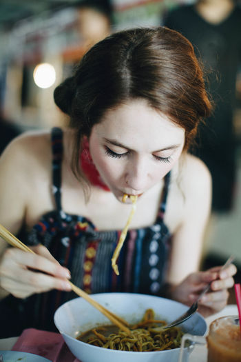 Woman Eating Noodle Soup At Home