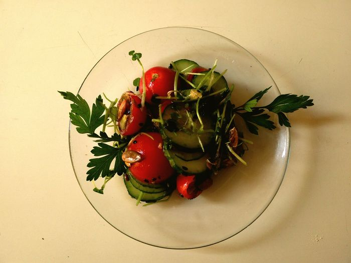 High Angle View Of Gluten Free Salad Served In Glass Plate On Table