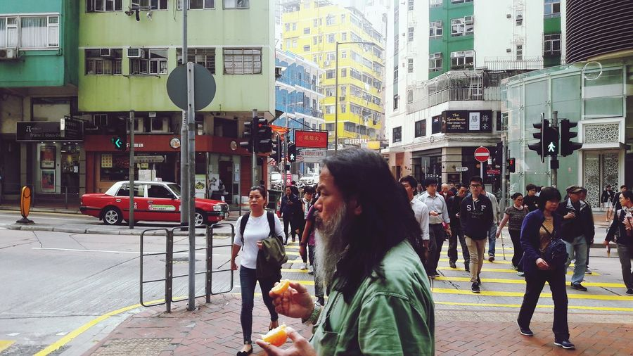 Street Photography Crowd Cityscape Crossroads ASIA Pedestrian People Hong Kong Hong Kong City EyeEm Hong Kong EyeEm Best Shots Strangers Old Man Architecture Day City Life City Street Road Real People Rush Hour Large Group Of People Orange Orange - Fruit Eat And Go Eat On The Street Colour Your Horizn The Street Photographer - 2018 EyeEm Awards