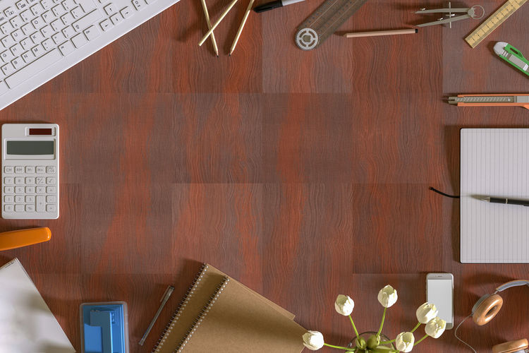 Directly above shot of office supplies on wooden table