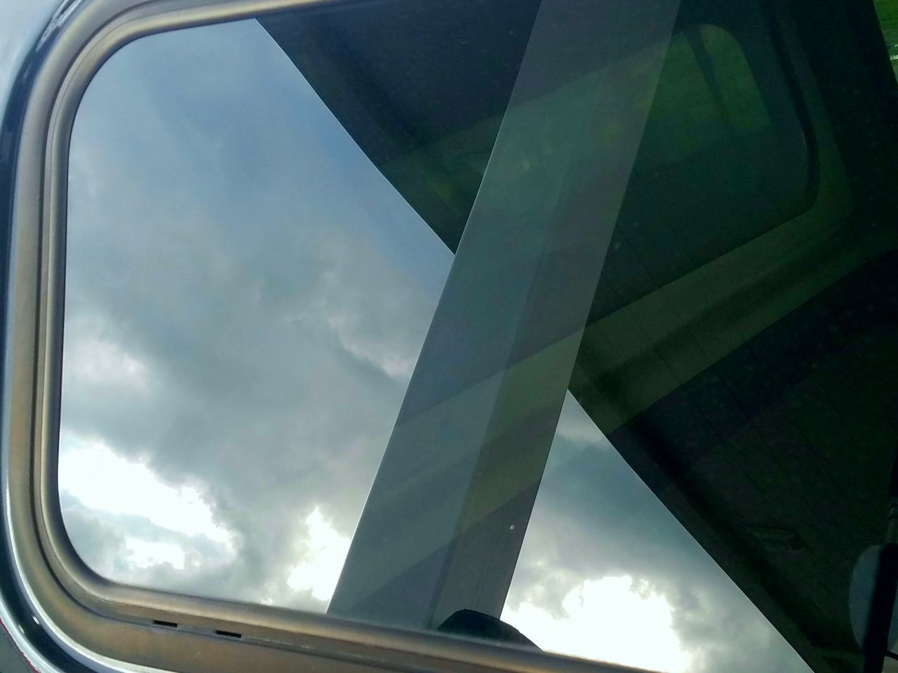 window, sky, transportation, mode of transport, day, low angle view, cloud - sky, no people, airplane, outdoors, close-up
