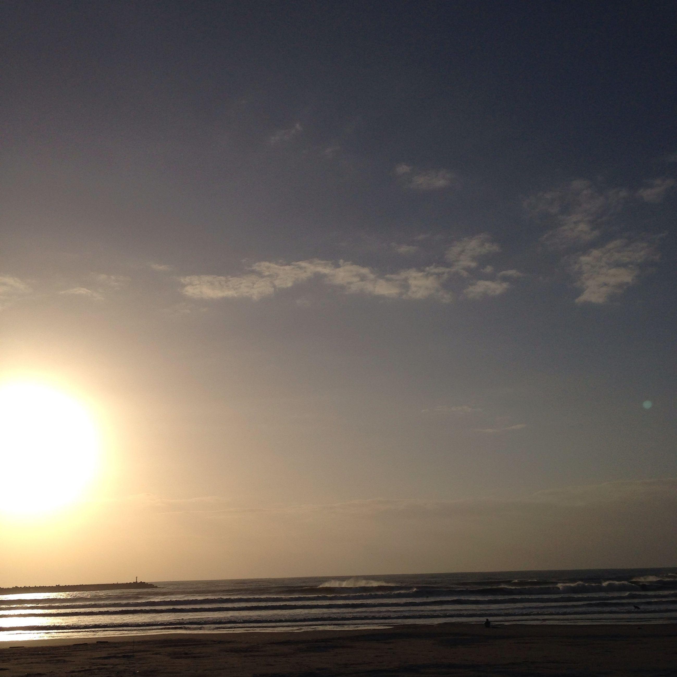 sea, horizon over water, water, beach, scenics, tranquil scene, tranquility, beauty in nature, sunset, sky, sun, shore, nature, idyllic, sand, sunlight, seascape, outdoors, remote, sunbeam