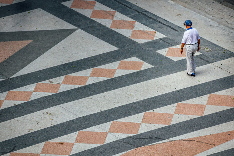 High angle view of man standing on road