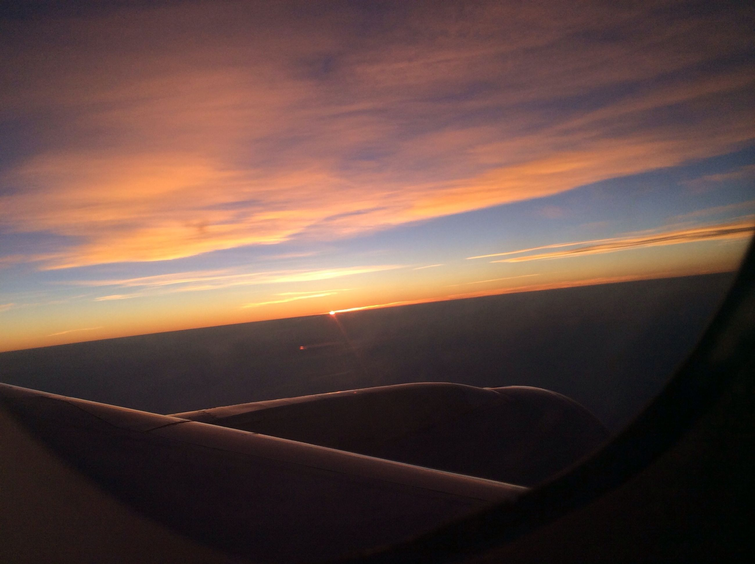 sunset, transportation, sky, scenics, landscape, beauty in nature, orange color, tranquil scene, tranquility, cloud - sky, nature, mode of transport, road, horizon over land, idyllic, airplane, cloud, travel, sun, no people