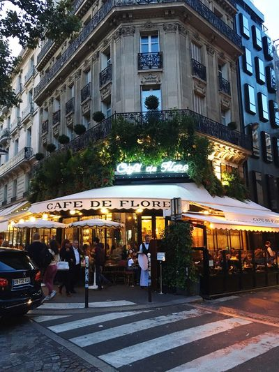Building Exterior Architecture Built Structure City Large Group Of People Men City Life Outdoors Travel Destinations Car Travel Illuminated Day Awning People Adults Only Real People Adult Cafe De Flore Paris