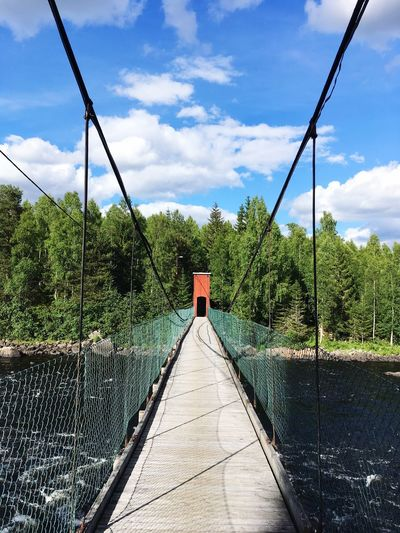 Hanging bridge Dala-Floda Bridge EyeEm Selects Sky Cloud - Sky Plant Nature Day Sunlight Park - Man Made Space Playground Green Color Security Architecture Blue The Way Forward Direction Shadow Growth Tree Empty No People Outdoors