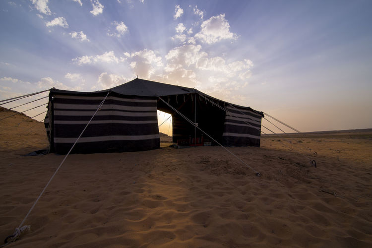 Tent At Desert Against Sky During Sunset