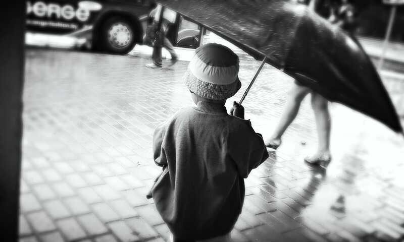 Little boy in the rain!