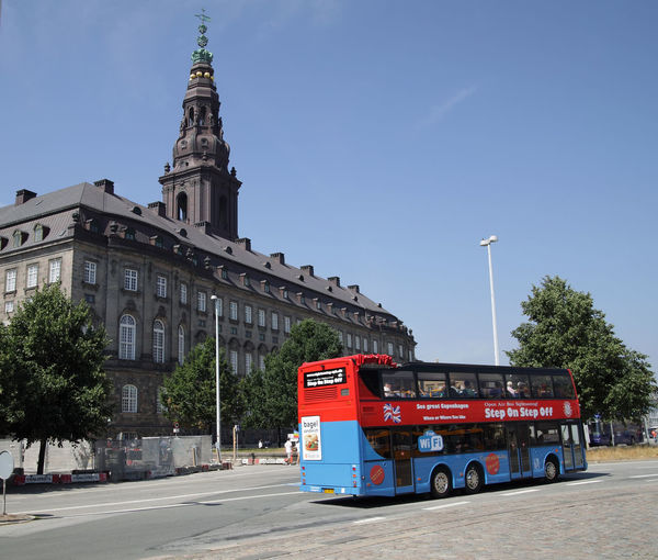 Sightseeing bus with tourists and Christiansborg, the danish parliament in background Copenhagen, Denmark Nordic Countries Scandinavia Sightseeing Tourist Attraction  Architecture Building Exterior Built Structure Bus Capital Capital Cities  City Copenhagen Danish Danmark Land Vehicle No People Outdoors Parlament Parliament Sightseeing Tour Tourism Tourist Destination Transportation Travel Destinations