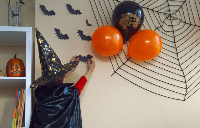 Low angle view of balloons on table at home