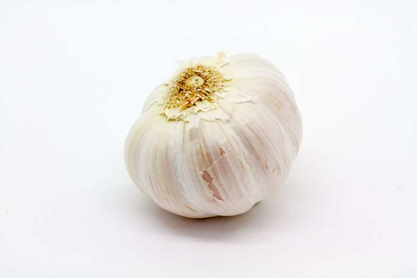 A Garlic Bulb Bulb Close-up Cooking Fragility Freshness Garlic Garlic Bulb No People Organic Pungent Spices Still Life Studio Shot White White Background Whole