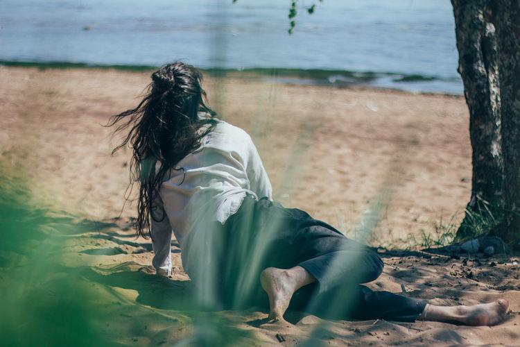 Woman dancing in beach