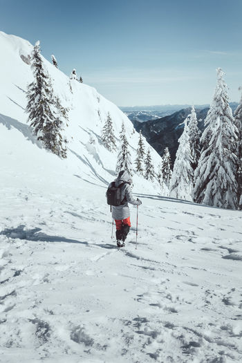 Snow Winter Cold Temperature Mountain Real People Leisure Activity Scenics - Nature Beauty In Nature Sky Lifestyles One Person Full Length White Color Day Rear View Nature Adventure Snowcapped Mountain Warm Clothing Mountain Range Outdoors Hiker Hiking Backpack Winter