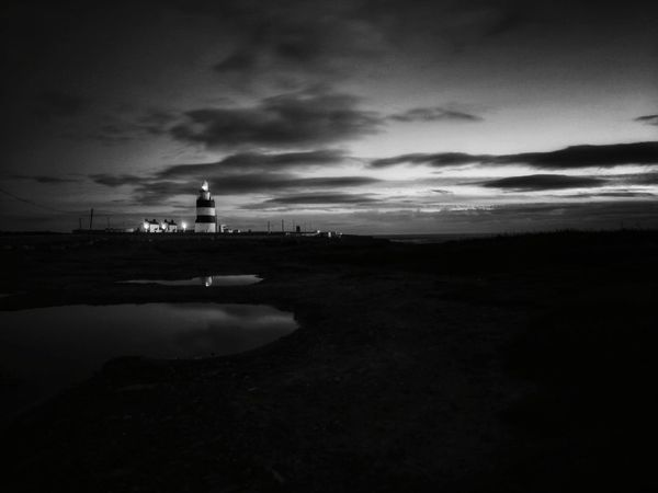 Hook Lighthouse, shades of grey. Hook Head, Ireland Wexford Ireland Ireland🍀 Lighthouse Dramatic Sky Reflection Building Exterior Cloud - Sky Silhouette Water Black & White Photography Landscape_photography Tranquility Beauty In Nature Coastline Landscape Huawei P10 Plus EyeEmNewHere ExploreEverything Outdoors Lighthouse Tower Shades Of Grey Lighthouse_captures Lighthouse_lovers Black And White Collection  Black And White Photography Perspectives On Nature Black And White Friday