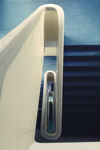 Low angle view of staircase by sea against sky