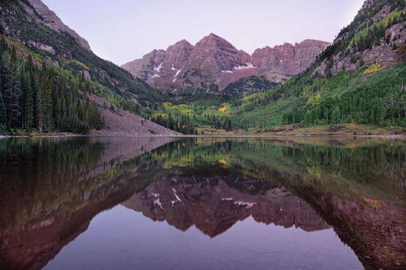 Maroon Bells, before sunrise Water Reflection Mountain Lake Scenics Tranquil Scene Tranquility Beauty In Nature Awe Travel Majestic Non-urban Scene Mountain Range Travel Destinations Tourism Nature Idyllic Wilderness Physical Geography Vacations (null)Sunrise