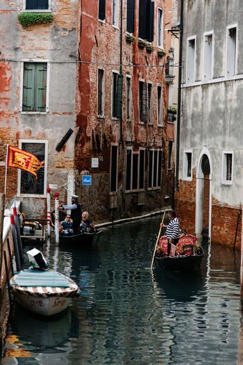 Nautical Vessel Transportation Building Exterior Mode Of Transportation Architecture Built Structure Water Canal Real People Group Of People Men Day Waterfront Building City Window Gondola - Traditional Boat Incidental People People Outdoors Venice Venice, Italy